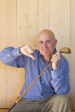 Man holding retro golf stick and thumb down Royalty Free Stock Image