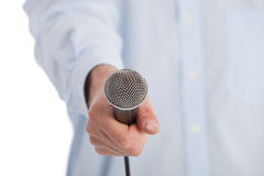 Man holding a retro microphone towards the camera Stock Photo