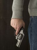 Man holding a revolver. A man holding a revolver for protection Royalty Free Stock Images