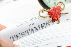 Man holding a rolled up scroll of last will and testament fastened with natural brown jute twine hemp rope. Man holding a rolled up scroll of last will and Royalty Free Stock Photo