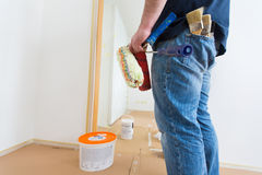 Man holding rollers and brushes royalty free stock photography