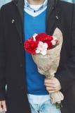 Man holding a romantic flower bouquet, close up Stock Photo