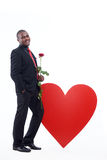 Man holding rose romantic present for Valentine Day. Royalty Free Stock Photography