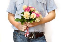 Man holding roses Royalty Free Stock Photography