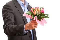 Man holding roses Stock Images