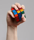 Man holding rubik cube in his hands Royalty Free Stock Image