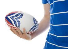 Man holding rugby ball. In hand against white background royalty free stock photo