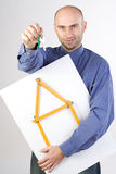 Man holding rulers and keys Royalty Free Stock Images