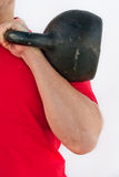 Man holding a Russian kettlebell Royalty Free Stock Image