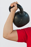 Man holding a Russian kettlebell Royalty Free Stock Photo