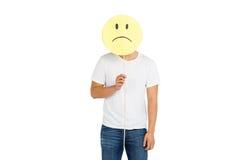 Man holding sad smiley face Stock Photography