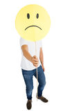 Man holding sad smiley face Stock Photos