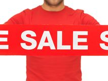 Man holding sale sign Stock Photo