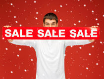 Man holding sale sign Royalty Free Stock Photos