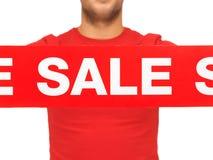Man holding sale sign Stock Photos