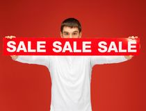 Man holding sale sign Royalty Free Stock Photography