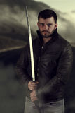 Man holding a samurai`s sword. Book cover design Stock Photography