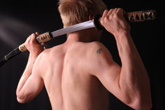 Man holding samurai sword Stock Photography