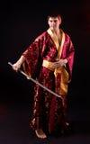 Man holding samurai sword Stock Images