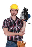 Man holding a  saw. Man holding a hand-held cold saw Royalty Free Stock Photography