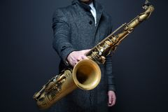 Man holding saxophone Stock Photo