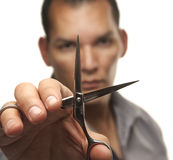 Man holding scissors Royalty Free Stock Images