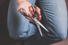 Man holding scissors Royalty Free Stock Photography