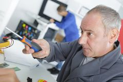 Man holding screw driver. Man holding a screw driver Royalty Free Stock Photos