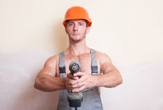 Man holding a screwdriver in the two arms Royalty Free Stock Photo