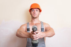 Man holding a screwdriver in the two arms Royalty Free Stock Photography