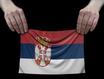Man holding Serbian flag Royalty Free Stock Image