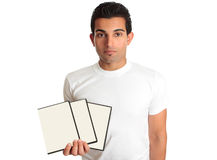 Man holding set DVD movies or games in his hand. A man holds a set of three DVD movies, games, software or other multimedia content in his hand Royalty Free Stock Image