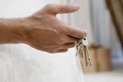 Man holding set of keys, close-up of hand, side view Royalty Free Stock Photo