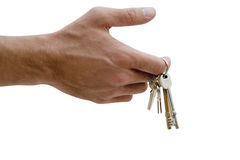 Man holding set of keys, close-up of hand, side view, cut out Royalty Free Stock Image