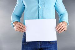 Man holding sheet of paper with space for text Royalty Free Stock Images