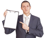Man holding a sheet of paper Stock Photography