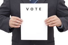 Man, Holding a Sheet with Title VOTE Stock Images