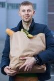 Man holding a shopping bag Stock Photos