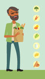 Man holding a shopping bag full of vegetables Stock Images