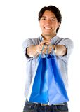 Man holding shopping bags Royalty Free Stock Image