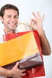 Man holding shopping bags. Upon returning home stock photos