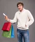 Man holding shopping bags and credit card Stock Image