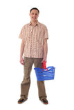 Man holding shopping basket Royalty Free Stock Photography