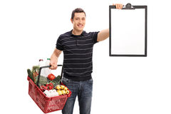 Man holding shopping basket and a clipboard Stock Photography