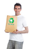 Man Holding Shopping Paper Bag Stock Photo