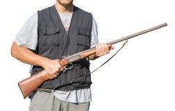 Man holding a shotgun. On white background Royalty Free Stock Photography