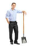 Man holding a shovel. Full length portrait of a man holding a shovel on white background Royalty Free Stock Photos