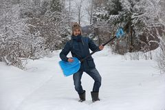 Man holding shovel like a guitar Royalty Free Stock Images