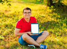 Man holding and shows touch screen tablet pc Royalty Free Stock Image