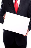 Man Holding Sign. A man in a blue business suit holding a white sign, begging, or giving information, with copy space stock image
